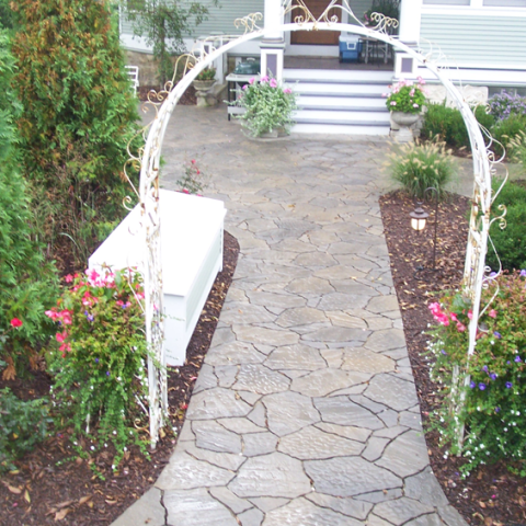 Arched Mega Arbel and Stone Front Entry Walkway