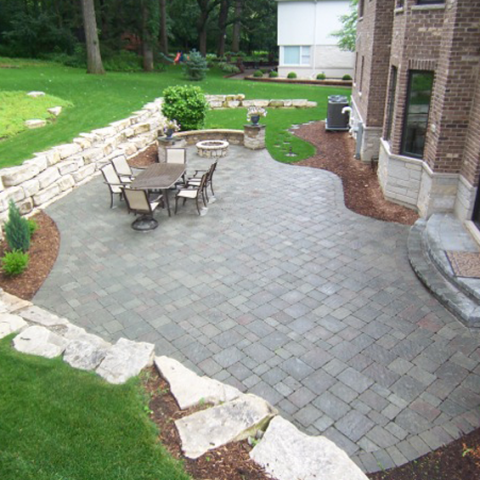 Stone Patio and Firepit with Outcropping Wall