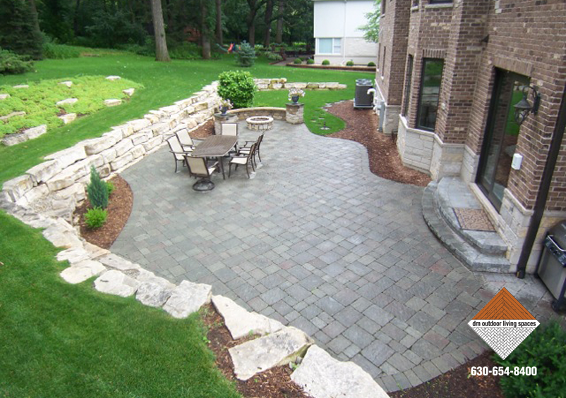 Stone Patio And Firepit With Outcropping Wall D M Outdoor Living Spaces