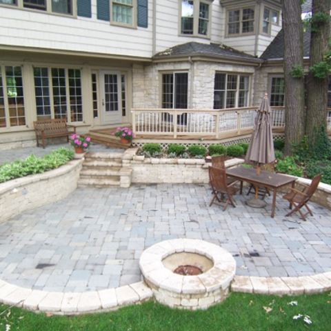 Heart Shaped Stone Patio with Wood Deck