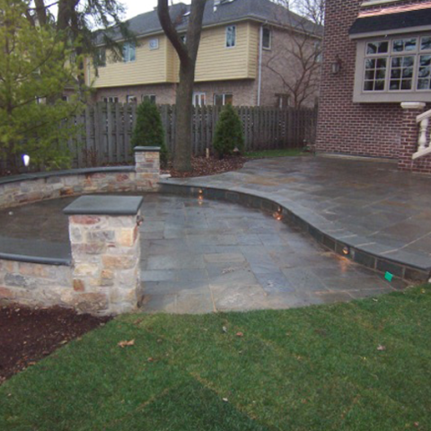 Blue Stone Circular Patio with Sitting Wall