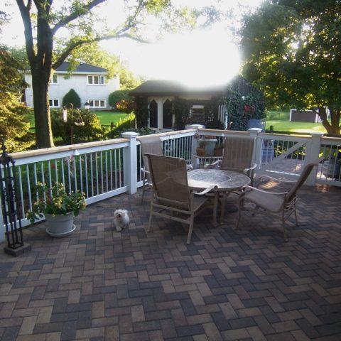 Wood rail on paver patio