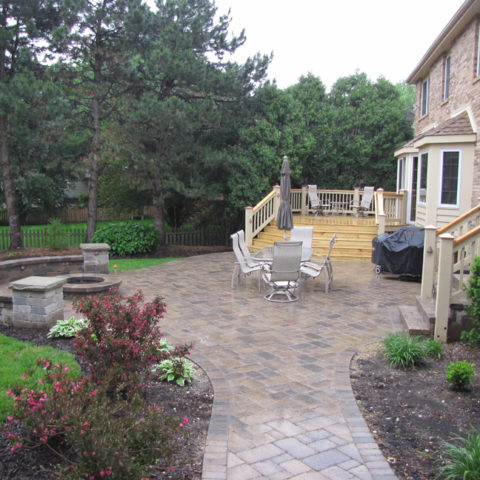 Stone patio, deck and circle fireplace