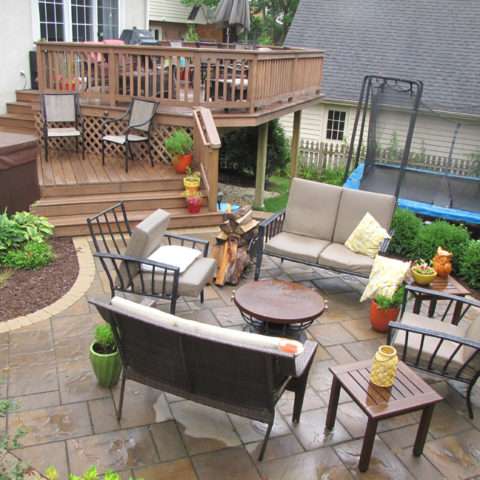 Deck and railing, surrounded by stone patio