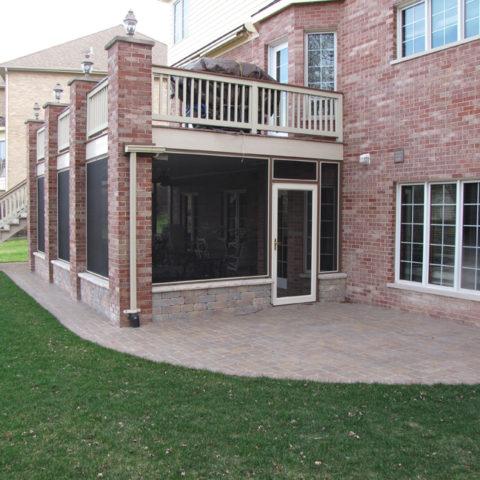 Stone patio screened enclosure