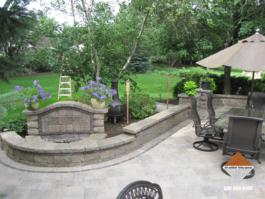 Stone patio with corner fireplace ... & Stone Fireplaces | Circular Fit Pits | Outdoor Fireplaces