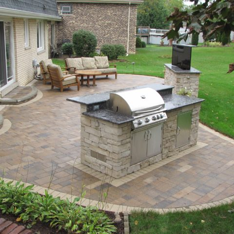 Patio pavers with TV stand and grilling station