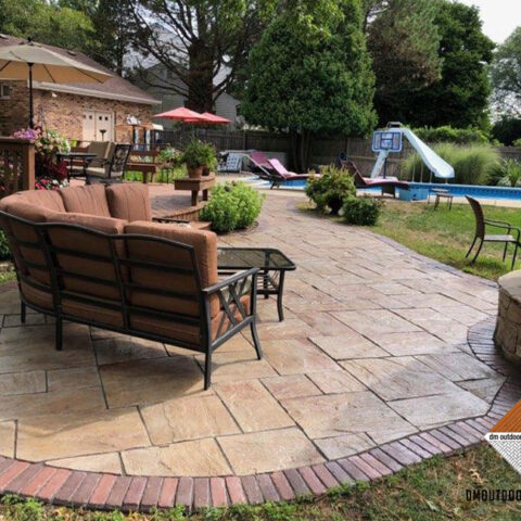 Pool deck and stone fireplace